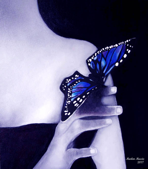 A butterfly resting on a woman's finger